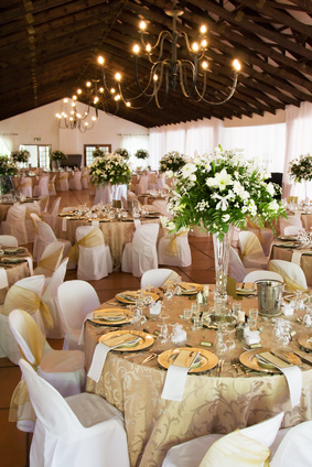 Wedding reception hall with tables, flowers and decor